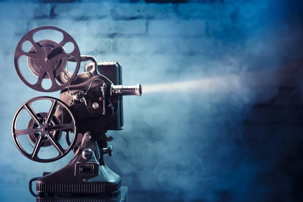 cinema_old film projector with dramatic lighting